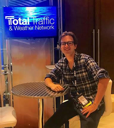 Dalton Allison sitting at the Total Traffic booth, where he currently works in NJ